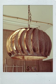LOVE this repurposed light fixture.  I just happen to have two of these!!  Wow. What an idea!!