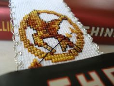 DIY Mockingjay Pin Cross-stitch Bookmark. Full instructions and pictures.