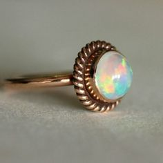 Beautiful 14k solid Rose gold opal proposal ring. Mesmerizing, finest natural opal ring. Natural gemstone is bezel set in solid 14k Rose gold, an artisan jewelry, Also, Opal is October birthstone. Great as engagement ring, proposal ring.