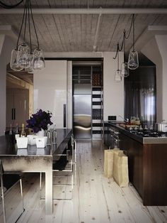 Stainless, white, and wood kitchen