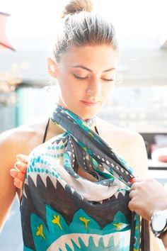 Halter Dress Step 2: Twist the scarf in front to create a keyhole. DIY: 4 Innovative Ways to Tie a Chic Summer Sarong | Big Fashion Show halter dress