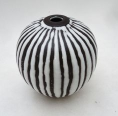 Dark clay vase with wax resist and white glaze. Keith Lehman of the Poplar Studio.