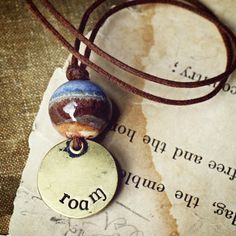 Roam- handmade ceramic landscape bead and rustic stamped brass necklace. Simple…