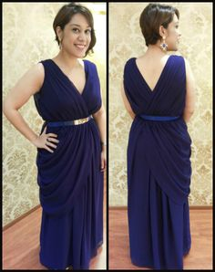 Feel like a million bucks in this breathtaking outfit by #TIARA. Swati is wearing a gorgeous blue gown with front and back pleats and a side drape making the entire outfit so classy and royal ! She has also accessorized it with a blue belt and a gold blue statement earrings!! We can customize this beauty in any solid color or shaded hues. Come over and order this right away!