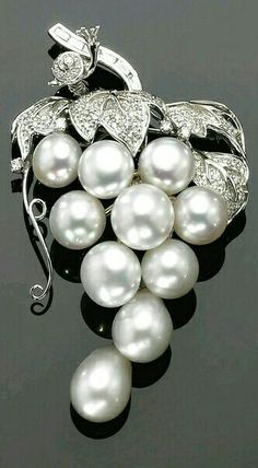 WHITE GOLD CULTURED PEARL AND DIAMOND BROOCH/PENDANT DESIGNED AS A BUNCH OF GRAPES EMBELLISHED WITH A LITTLE SNAIL
