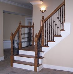 Adorn Staircase Using Beautiful Iron Stair Railing: Charming Interior Design With Iron Stair Railing And Wood Handrails Also Wall Sconce With Interior Paint Color