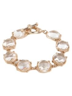 Talk about crystal clear. This stunning statement bracelet features a gorgeous lineup of massive crystal gems, each beautifully faceted and completely see-through.  This is part of the ELLE Holiday Shop