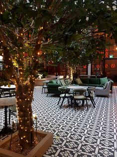 Refuge Volta Manchester Winter Garden The glamorous interiors of Refuge in Manchester are shared and recreated with an achievable design plan in a get-the-look mood board. Garden Tiles, Patio Tiles, Garden Floor, Outdoor Tiles, Outdoor Spaces, Outdoor Living, Outdoor Decor, Terrace Floor, Outdoor Flooring