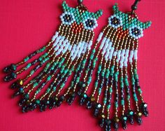 cute horned owl seed bead fringe earrings! Delica owl earrings with bronze luster crystal sparkle. tufted owls in turquoise and AB white