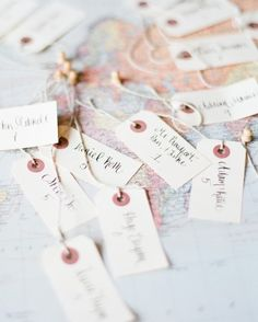 To make the escort cards, Ashley purchased basic ivory place cards from Paper Source and embellished the bottom borders with washi tape in varying patterns.