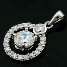 A Big Zircon in the Central of the Round Shape Hearts and Arrows Sterling Silver Pendant