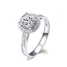 Circle cut diamond engagement ring