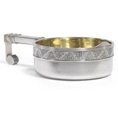 A Fabergé silver kovsh, Moscow, 1908-1917, the rim cast with oak leaves and bead swirls, squared hook handle, gilt interior, struck K.Fabergé in Cyrillic beneath the Imperial Warrant, 88 standard, the scratched inventory number obliterated, French import mark.