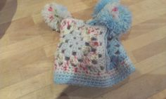 Baby bobble hat - 3 granny squares  5 rows of single crochet. Topped with 3 pompoms