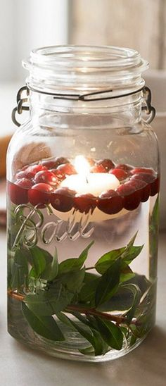I love this idea of floating candles in mason jars for Christmas time! Noel Christmas, All Things Christmas, Winter Christmas, Christmas Crafts, Simple Christmas, Christmas Candles, Christmas Wedding, Christmas Centerpieces, Christmas Ideas
