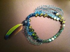 Woven enamel wire, feather necklace