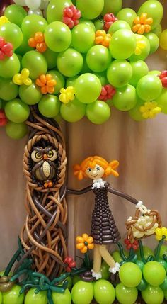 A balloon garden with tree, owl and a little girl enjoying summer. Beautiful balloon art.