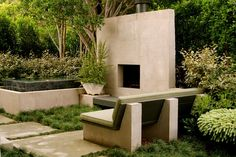 Strong contrast between the large concrete pieces and the wild, wavy plantings is the appeal.