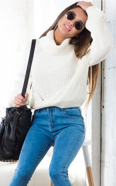 Knots and Crosses knit sweater in white | SHOWPO Fashion Online Shopping $60 Featuring a cozy turtleneck fit, this cute pullover sweater has a gorgeous and intricate knit pattern with delicate cut out detailing at the waist. Perfect for winter and rainy days, style with a pair of jeans for a casual outfit that can't go wrong.