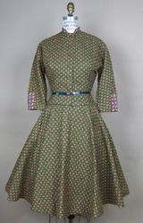 This is a dress that Prudy Pingleton would wear. She was a very conservative woman who strongly believed in God. This dress fit her personality completely.