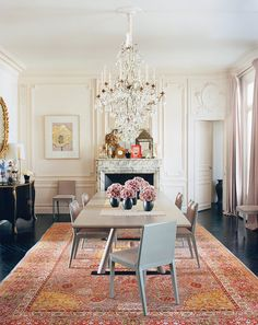 A modern custom Christophe Delcourt and gray lacquered chairs contrast with historic details in the late L'Wren Scott's Parisian apartment.