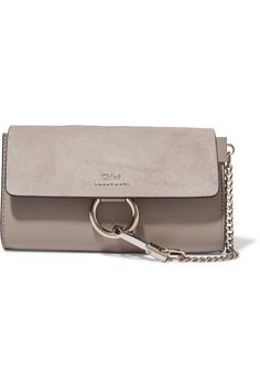 Gray leather and suede (Calf) Snap-fastening front flap Designer color: Motty Gray Comes with dust bag Weighs approximately 1.1lbs/ 0.5kg Made in Italy