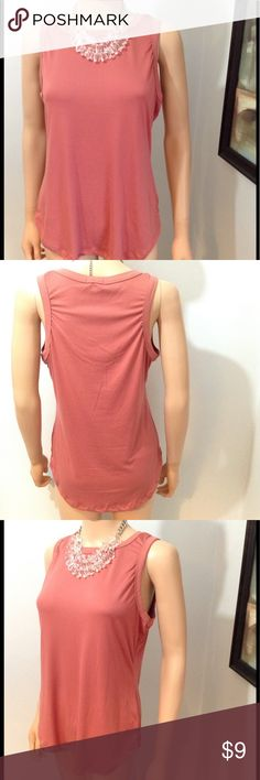 Cute Tank Cute tank flowing doesn't  fit tight to the body allows you to wear with leggings. Tank has a good soft feel accented in a beautiful dark melon color with a hi-low design. Materials are 92% polyester, 8% spandex. Rue 21 Tops Tank Tops