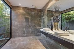 Shower room with full height window to private garden. Modern Melbourne architecture and design
