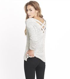 Sexy back! This grey shaker stitch sweater features a unique criss cross back!