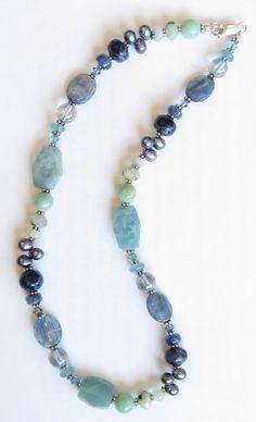 Mix of kyanite, aquamarine, lapis, amazonite, freshwater pearls, & glass from Blue Door Beads