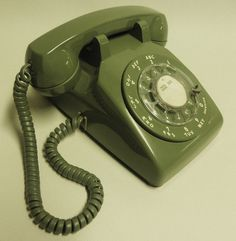 Rotary phone.  For a while, all accessories, appliances and carpets were avocado green...my mum's bathroom still is!