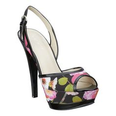 """CORINNE As seen on the cover of  the April issue of People Style Watch.....Peep toe platform sling back sandal.  Adjustable buckle closure.  Measurements: 5.5"""" heel and 1.5"""" platform. This style is available exclusively @ Nine West Stores & ninewest.com."""