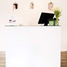 White reception desk at Swedish Beauty Factory salon.