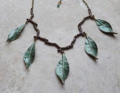 Lovely hand painted green elven leaf necklace,  I have made this necklace using brass leaves