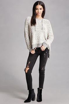 A fuzzy popcorn-knit sweater featuring a drawstring hood, dropped long sleeves, contrast ribbed trim, and a vented hem. This is an independent brand and not a Forever 21 branded item.