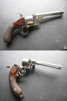 Devisme Mle 1859 revolver    Manufactured in France c.1859-70.  11mm Devisme six-round cylinder, single action, top break action.  The ratchet and pinion system that opens up the gun also rotates the manual ejector rod to be in line with the cylinder's chamber.  It's an overall very odd layout, inspired by the earlier Mle 1855, a percussion design.