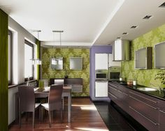 Spectacular Kitchen Design with Green Color Theme on the Kitchen Wall Painting Decorating and the Kitchen Have a Wooden Floor that Make Kitchen View so Beautiful http://www.urbanhomez.com/decors/kitchen Get Latest Designs & Decor Ideas for your Home at http://www.urbanhomez.com/decorhttp://www.urbanhomez.com/profile/hacker_kitchens http://www.urbanhomez.com/construction/modular_kitchen,_fittings_and_accessories