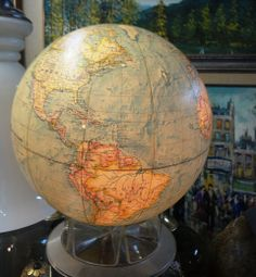 Vintage globe lamp with stand.