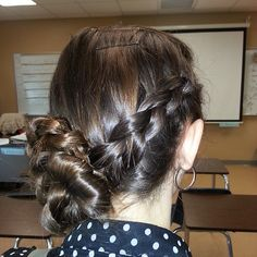 Photo by blazesymone braoded updo katnis braid to the side then twisting it up into a bun (: