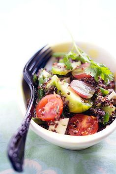 Salad with greens, tomatoes, red quinoa, and something that looks like squash. Yummm.