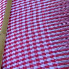 Make your own blanket on a handmade blanket weaving loom.