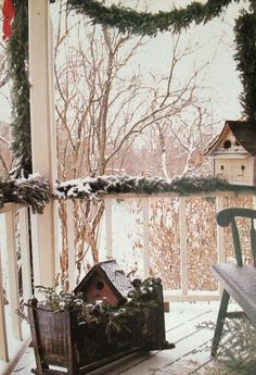 Greens on the porch railings, use grapevine wreaths on the door