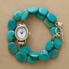 """TURQUOISE WRAP WATCH--New way to wear turquoise, in blue-green ovals forming the band of our double wrap watch. Sterling silver toggle clasp. Silver-tone case. Quartz movement. Made in USA. Exclusive. Fits up to 7-1/4"""" wrists"""