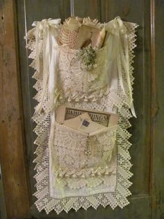 I made this door hanger from a large lace scarf, smaller lace pieces and vintage trims...I tucked old photos,music and old love letters in it...looks sweet hanging on the back of your bathroom door