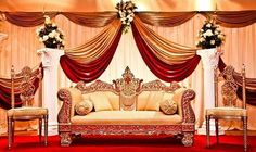Stunning & luxurious red & gold wedding stage!