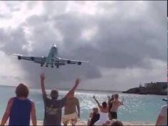 planes take off at maho beach st maarten airport beach