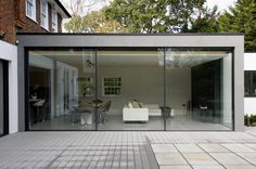 + exterior view of minimal windows to rear extension in London showcasing their minimal framing www.iqglassuk.com