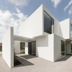 House DZ in Mullem by Graux. This house in Belgium by Ghent studio Graux & Baeyens Architecten is broken down into cubic volumes that are staggered to let more light into each room.