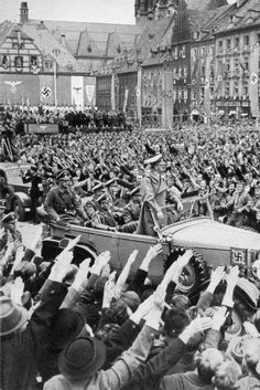 October Hitler (standing in Mercedes) drives through the crowd in Cheb (German: Eger), part of the German-populated Sudetenland region of Czechoslovakia, which was annexed to Nazi Germany due to the Munich Agreement Munich Agreement, German People, Germany Ww2, The Third Reich, Historical Pictures, World History, World War Two, Wwii, The Past