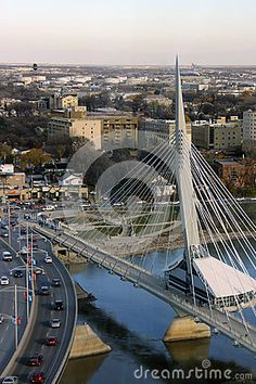 Espanade Riel Walking Bridge Famous Winnipeg walking bridge, going from the Forks to St. Boniface, beside the Provencher bridge. With a restaurant in the middle, and views of the Forks, the Red River and the Assiniboine, it lies at the heart of Manitoba.
